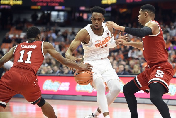 North Carolina State guard Markell Johnson steals the ball from Syracuse forward Oshae Brissett during Wednesday's game at the Carrier Dome. It was one of 15 turnovers for the Orange.