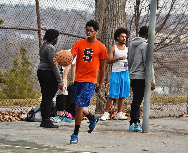 In this Feb. 22, 2017, file photo, Corcoran High School student Chris Freeman plays basketball in Syracuse as temperatures reached into the 60s. Highs in the 60s are expected Tuesday and Wednesday.