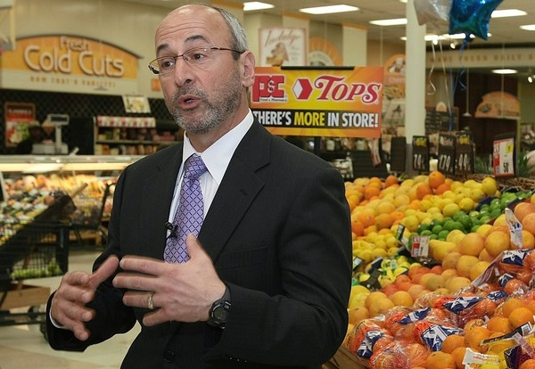 Tops CEO Frank Curci speaks to the media during a visit to its store in Fayetteville, a former P&C Foods store, in 2010. Tops filed for reorganization Wednesday under Chapter 11 of U.S. Bankruptcy Code.