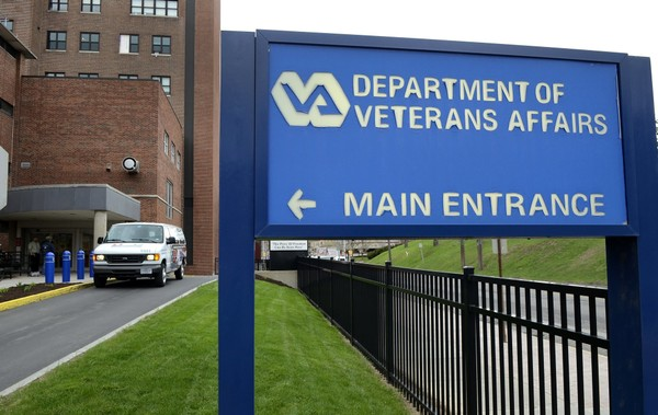A minivan waits to pick up veterans getting medical care at the Syracuse VA Medical Center.