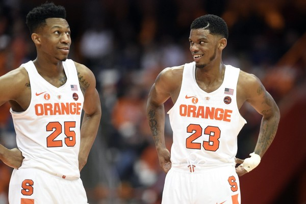 Syracuse guard Tyus  Battle (25) and Syracuse guard Frank Howard (23) during a game against North Carolina State on Wednesday, Feb. 14, 2018, at the Carrier Dome. Dennis Nett | dnett@syracuse.com