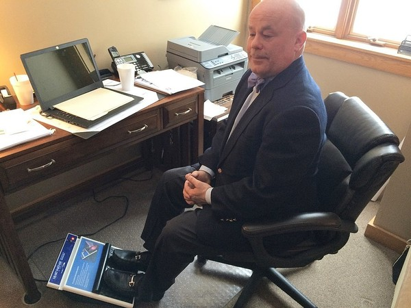 Sonostics Executive Vice President Kyle Washington demonstrates the company's foot vibrator in Sonostics' office in Camillus on Monday, March 5, 2018. (Rick Moriarty photo)