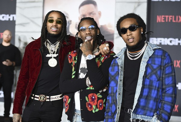 "Quavo, from left, Offset and Takeoff, of Migos, arrive at the U.S. premiere of ""Bright"" at the Regency Village Theatre on Wednesday, Dec. 13, 2017, in Los Angeles."