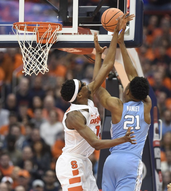 Syracuse center Paschal Chukwu (13) and North Carolina forward Sterling Manley (21) during a game  Wednesday, Feb. 21, 2018, at the Carrier Dome.Dennis Nett | dnett@syracuse.com