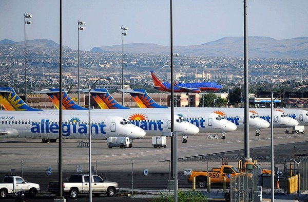 Allegiant Air jets are parked at McCarran International Airport in Las Vegas.  (AP Photo/David Becker)