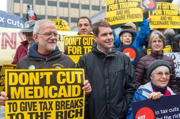 Howie Hawkins (left) stands next to Ben Walsh to protest the visit of U.S. Small Business Administration boss Linda McMahon on Nov. 6, 2017 in front of the Tech Garden in Syracuse, N.Y. N. Scott Trimble | strimble@syracuse.com(N. Scott Trimble)