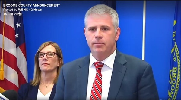 Screen shot of Nancy Williams, Commissioner of the Department of Social Services, and Broome County Executive Jason Garnar.