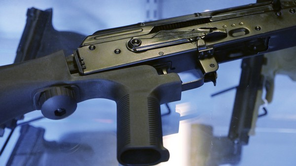 A device called a bump stock is attached to a semi-automatic rifle at the Gun Vault store and shooting range in South Jordan, Utah in this Oct. 4, 2017 file photo. The Trump administration is proposing banning bump stocks, which allow guns to mimic fully automatic fire and were used in last year's Las Vegas massacre. The Justice Department's regulation, announced Saturday, March 10, 2018, would classify the device as a machine gun prohibited under federal law.
