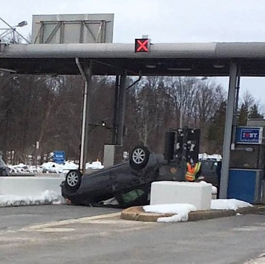 The driver of this Toyota Prius flipped the car upside down Sunday afternoon at the Thruway Exit 33 toll booth in Verona. State police say the driver, Charles D. Whittier, 54, of Rome, was under the influence of marijuana and not paying attention when the crash happened.