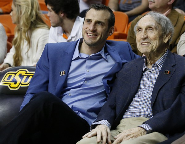 """Fox Sports commentator Doug Gottlieb thinks it is 'laughable' that the Orange are in the 2018 NCAA Tournament. He joins Brent Axe on the """"Syracuse Sports Podcast"""" to discuss. In this photo, former Oklahoma State basketball coach Eddie Sutton, right, is pictured with Gottlieb, left, during an NCAA college basketball game between Baylor and Oklahoma State in Stillwater, Okla., Wednesday, Jan. 27, 2016."""