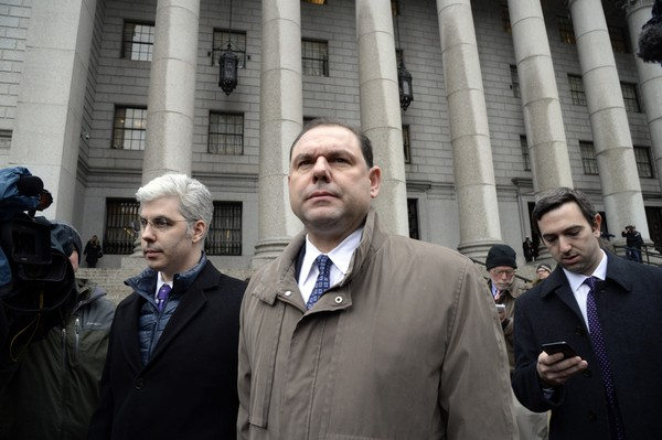 Joseph Percoco, center, a former top aide to Gov. Andrew Cuomo, leaves U.S. District Court in Manhattan after being found guilty on three counts and not guilty on four counts in his trial for bribery on Tuesday, March 13, 2018, in New York City, N.Y. (Marcus Santos/New York Daily News/TNS)