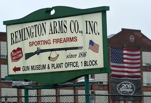 Sign points to the Remington Arms Co. gun museum and manufacturing plant in Ilion.