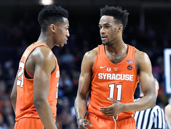 Syracuse guard Tyus Battle (25) and Syracuse forward Oshae Brissett (11) during a game against Virginia on Tuesday, Jan. 9, 2018, at John Paul Jones Arena in Charlottesville, Va. (Dennis Nett | dnett@syracuse.com)