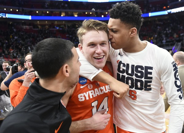 Syracuse guard Braedon Bayer (14) gets a hug from Matthew Moyer after the Orange's win over Michigan State in the NCAA Tournament. Bayer will transfer to another school as a fifth-year graduate transfer. (Dennis Nett | dnett@syracuse.com)
