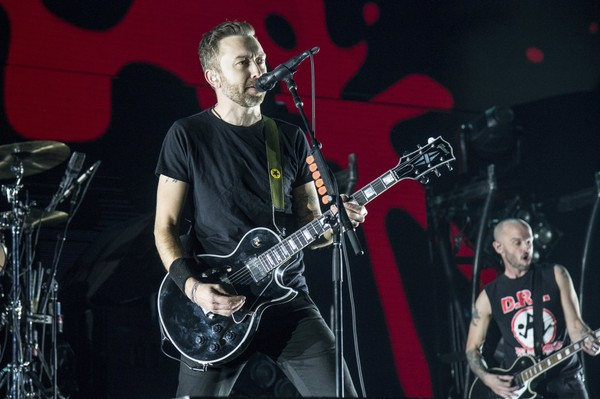 Tim McIlrath of Rise Against performs at the 2017 KROQ Almost Acoustic Christmas at The Forum on Saturday, Dec. 9, 2017, in Inglewood, Calif. Rise Against is among the headline acts at 2018 K-Rockathon at the Lakeview Amphitheater in Geddes.