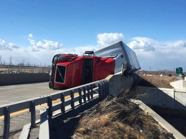 In this file photo, a tractor trailer is overturned on Route 190 in the town of Niagara because of high winds. A high wind warning is in effect for Western New York.(Syracuse.com)