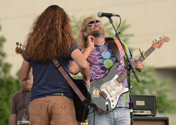 Anders Osborne (facing the camera) performs with bassist Carl Dufresne during the New York State Blues Festival in 2012.