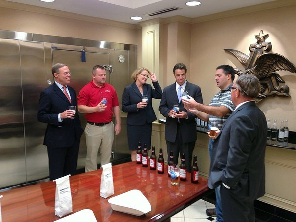Gov. Andrew Cuomo, third from right, tastes a Budweiser at the Anheuser-Busch brewery near Baldwinsville along with, from left, Assemblyman Will Barclay, then-brewery plant manager Nick Mills, Onondaga County Executive Joanie Mahoney,  brewer Nick Offredi, and Sen. John DeFrancisco. File photo Oct. 1, 2015.