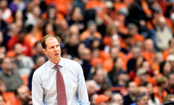 Mike Hopkins looks at the clock as Syracuse's interim coach during a game against Cornell at the Carrier Dome on Dec. 19, 2015.