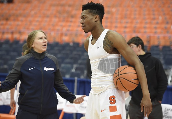 Katie Kolinski grad assistant coach at Syracuse talks to Syracuse guard Tyus Battle (25) before a game against Pittsburgh on Tuesday, Jan. 16, 2018, at the Carrier Dome. Dennis Nett | dnett@syracuse.com