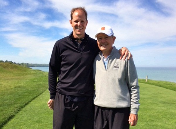 Mike Hopkins and his father, Griff Hopkins, on the golf course.