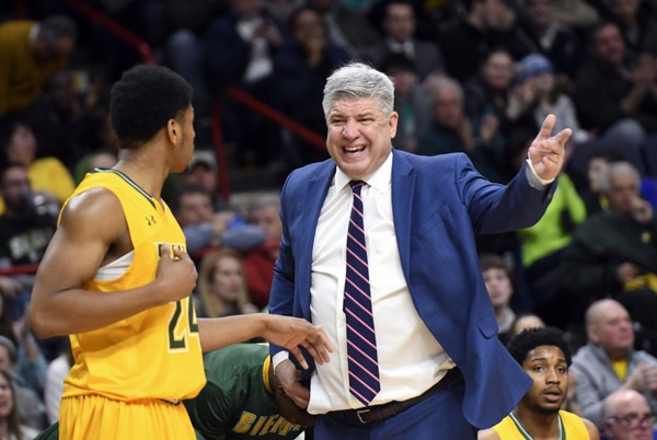 Siena guard Lavon Long (24) talks with Siena head coach Jimmy Patsos during the first half of an NCAA college basketball game in the championship of the Metro Atlantic Athletic Conference tournament on Monday, March 6, 2017, in Albany, N.Y.