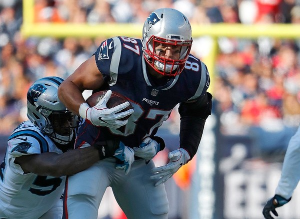 New England Patriots tight end Rob Gronkowski tries to break a tackle during a game against the Carolina Panthers in a file photo.