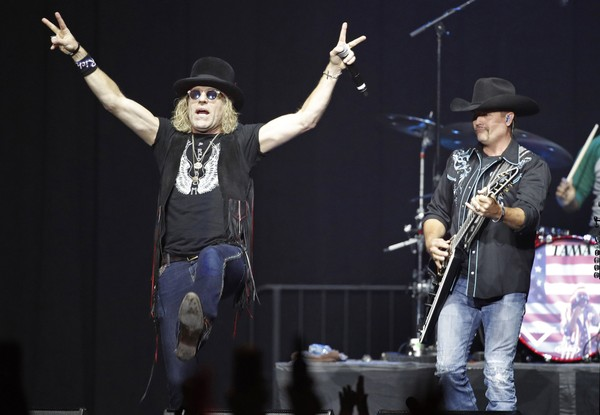 Big Kenny, left, and John Rich of Big & Rich perform during a benefit concert honoring first responders and those affected by the recent Las Vegas mass shooting, Thursday, Oct. 19, 2017, in Las Vegas.