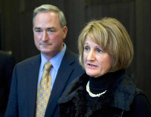 File photo of Cynthia Gifford speaking to reporters as her husband Robert Gifford listens on Nov. 23, 2015, in Albany, N.Y. The Giffords, owners of Liberty Ridge Farm refused to host the 2013 wedding of Melisa and Jennie McCarthy, citing their belief that marriage is between a man and a woman.