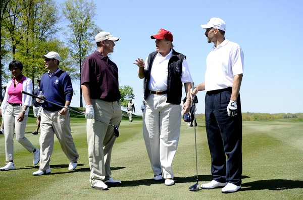 "Former Atlanta Braves pitchers Tom Glavine (L) and John Smoltz (R) talk with Donald J. Trump during a taping of ""Trump's Fabulous World of Golf"" at the Trump National Golf Club on April 23, 2010 in Bedminster, New Jersey."