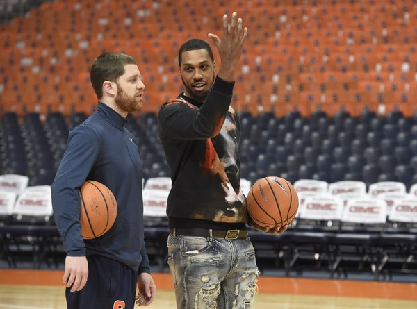 Former Syracuse player Eric Devendorf and Kris Joseph watch the current players warm up before the game against Eastern Michigan on Wednesday, Dec. 27, 2017, at the Carrier Dome. Dennis Nett | dnett@syracuse.com