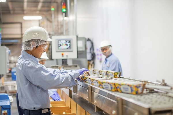 Workers box Greek yogurt coming off the production line at the Chobani factory in South Edmeston.
