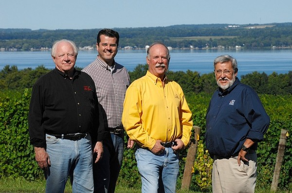 Owners of a company that is selling Finger Lakes wines in Europe left to right: John Martini of Anthony Road Wine Co., Chris Misssick of Villa Bellangelo, Scott Osborn of Fox Run Vineyards, together with European partner, Christian Claessens.(New York Wines SaRL)
