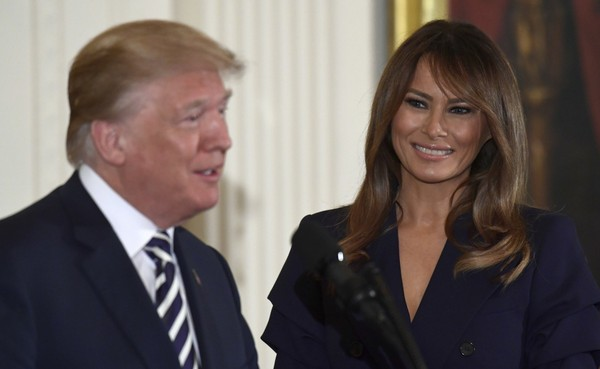 President Donald Trump speaks while first lady Melania Trump listens in the East Room of the White House May 9, 2018. (AP Photo/Susan Walsh)