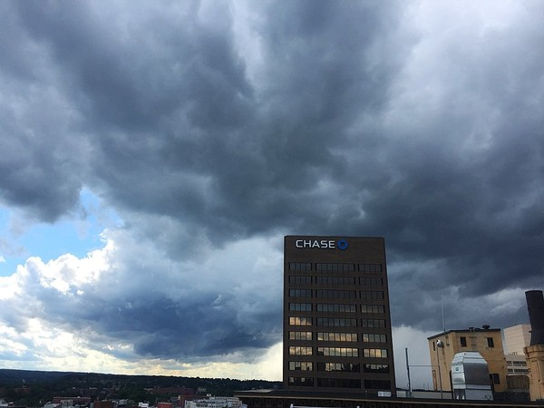 Storm clouds move in over Syracuse in this June 20, 2017, file photo.