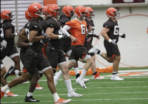 In this May 4, 2018, photo, Cleveland Browns quarterback Baker Mayfield (6) runs a drill during rookie minicamp at the NFL football team's training camp facility in Berea, Ohio. (AP Photo/Tony Dejak, File)