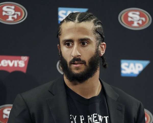 FILE - This Jan. 1, 2017, file photo shows then San Francisco 49ers quarterback Colin Kaepernick speaking at a news conference after the team's NFL football game against the Seattle Seahawks in Santa Clara, Calif. NFL spokesman Joe Lockhart says the league expects Colin Kaepernick to be invited to the next meeting between owners and players to discuss social justice initiatives. Lockhart adds that the meeting probably will take place next week.