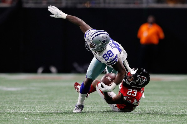 Dez Bryant (88) of the Dallas Cowboys is tackled by Robert Alford (23) of the Atlanta Falcons in this 2017 file photo. (Kevin C. Cox/Getty Images)