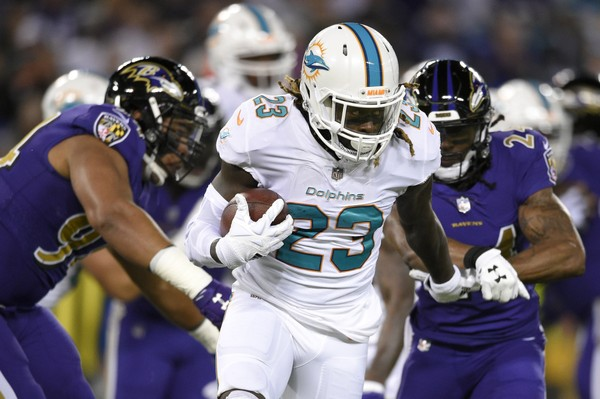 Miami Dolphins running back Jay Ajayi (23) rushes the ball in the first half of an NFL football game against the Baltimore Ravens, Thursday, Oct. 26, 2017, in Baltimore. (AP Photo/Nick Wass)