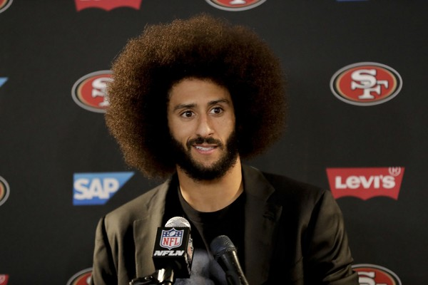 This Dec. 24, 2016 photo shows San Francisco 49ers quarterback Colin Kaepernick talking during a news conference after an NFL football game against the Los Angeles Rams.