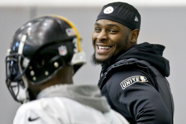 Pittsburgh Steelers running back Le'Veon Bell (26), right, smiles while talking to running back Fitzgerald Toussaint (33) as he participates in an NFL football practice, Thursday, Jan. 11, 2018, in Pittsburgh. (AP Photo/Keith Srakocic)