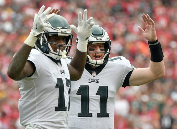 Philadelphia Eagles wide receiver Alshon Jeffery (17) and quarterback Carson Wentz (11) give the touchdown sign after Jeffery scored a touchdown.