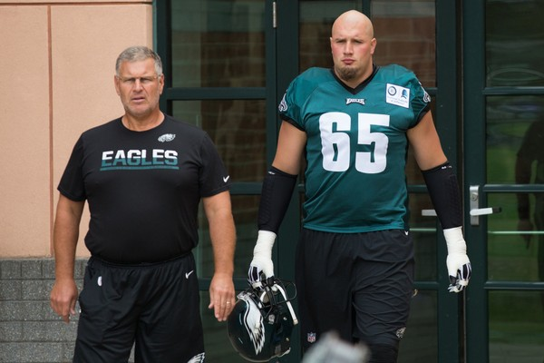 Philadelphia Eagles offensive line coach Jeff Stoutland (left) and tackle Lane Johnson (65) walk out of the locker rooms for training camp at NovaCare Training Complex.(Bill Streicher-USA TODAY Sports)