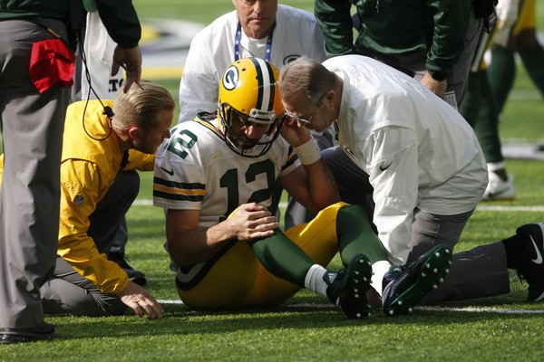 Green Bay Packers quarterback Aaron Rodgers gets up after being hit by Minnesota Vikings outside linebacker Anthony Barr (55) in the first half of an NFL football game in Minneapolis, Sunday, Oct. 15, 2017. (AP Photo/Jim Mone)