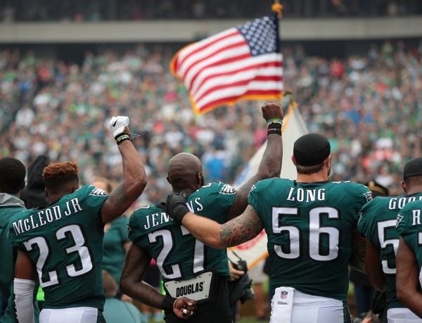 Malcolm Jenkins #27 and Chris Long #56 of the Philadelphia Eagles stand during the National Anthem during the first quarter at Lincoln Financial Field