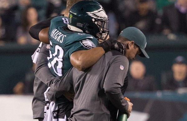 Philadelphia Eagles middle linebacker Jordan Hicks (58) is helped off the field after being injured during the first quarter against the Washington Redskins  at Lincoln Financial Field in Philadelphia. Pa. on Oct. 23, 2017. (Bill Streicher | USA TODAY Sports)
