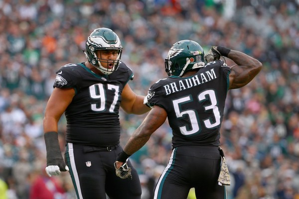 Outside linebacker Nigel Bradham #53 of the Philadelphia Eagles celebrates his sack with teammate defensive tackle Destiny Vaeao #97 against the Denver Broncos.