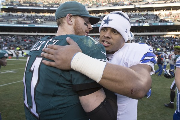 Carson Wentz of the Philadelphia Eagles hugs Dak Prescott of the Dallas Cowboys after the game at Lincoln Financial Field on January 1, 2017 in Philadelphia, Pennsylvania. The Eagles defeated the Cowboys 27-13. (Mitchell Leff | Getty Images)