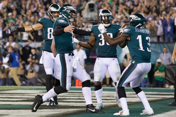 Philadelphia Eagles wide receiver Nelson Agholor (13) celebrates with quarterback Carson Wentz (11) after his touchdown catch during the fourth quarter against the Washington Redskins at Lincoln Financial Field. (Bill Streicher|USA TODAY Sports)