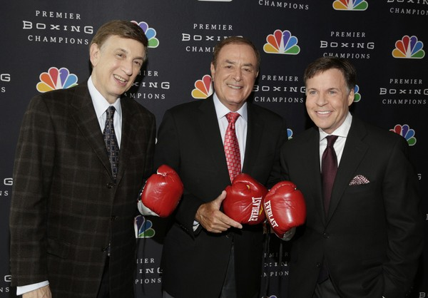 """In this photo provided by NBC, sportscasters Marv Albert, left, Al Michaels, center, and Bob Costas pose for a photo at a news conference in New York, Friday, April 10, 2015. The first prime-time fights on NBC as part of """"Premier Boxing Champions"""" drew strong ratings. The new series, which returns Saturday, could change how often some boxers get in the ring. (AP Photo
